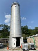Activated carbon tank, stainless tank inside stainless shell, cone bottom, approximately 35'
