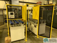 OVERALL BID LOTS 156-159; ROBOT PRESS CELL **Loading fee due Griner $600.00 price valid until 3/19**