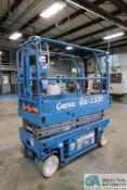 """GENIE MODLE GS-1530 ELECTRIC SCISSOR LIFT; S/N 24168, 15' MAX HEIGHT, 500 LB. MAX WEIGHT, 64"""" - 101"""""""