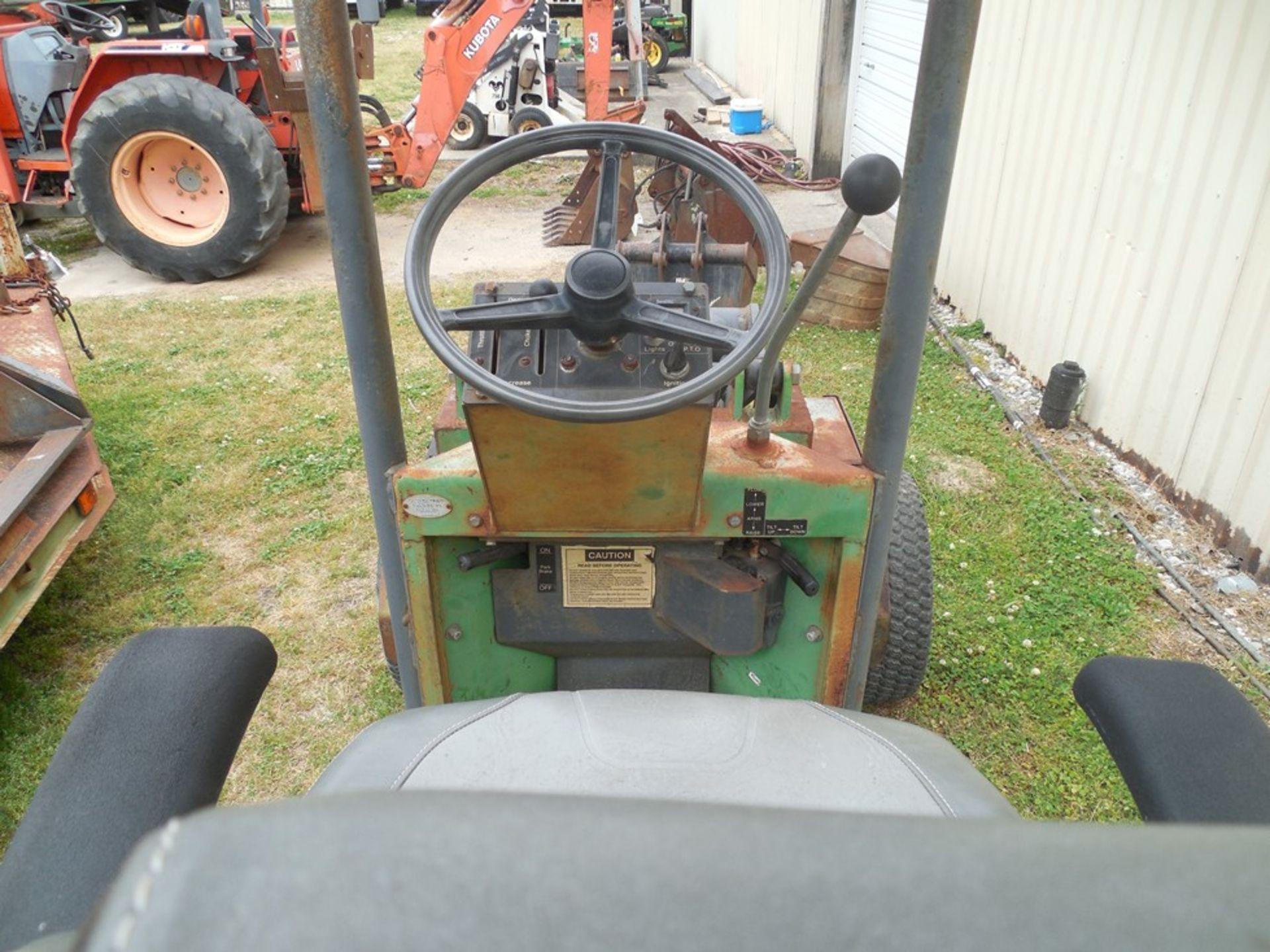 Power Trac PT-2425 Mini Skid Steer ser# 18928 with trailer, power rake, tree spade, front bucket, - Image 6 of 13