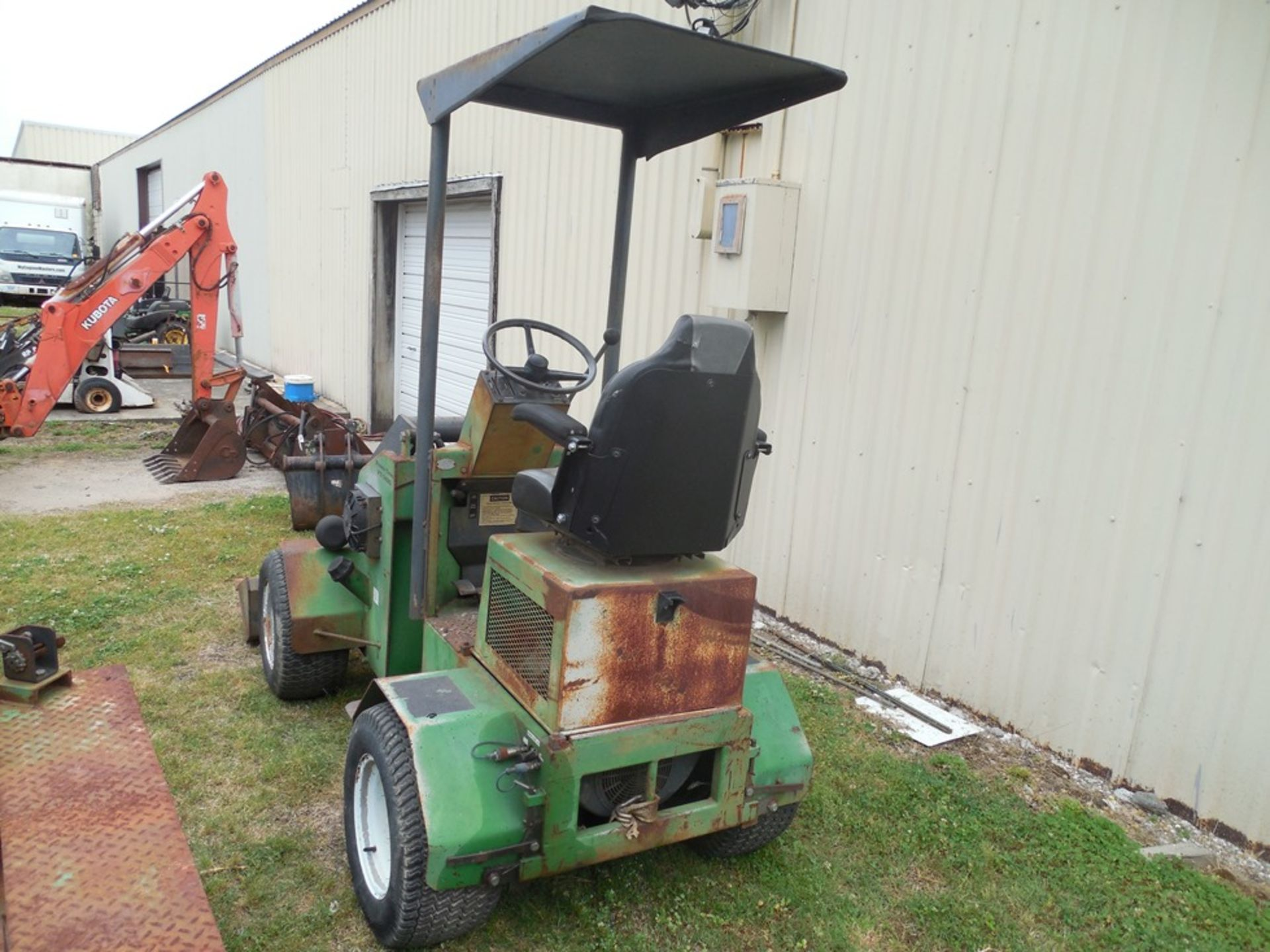 Power Trac PT-2425 Mini Skid Steer ser# 18928 with trailer, power rake, tree spade, front bucket, - Image 5 of 13