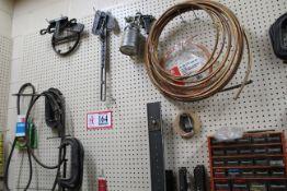 Contents of Peg Board: C-Clamps, Saws, Belts, Paint Gun, Flexible Copper Tubing, Etc.