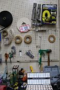 Contents of Wall & Table: Dremel 300 Rotary Tool, Wood Clamps, Various Pins, Tape, Ratchet Tie