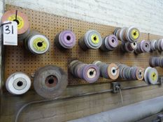 LOT: ASSORTED GRINDING WHEELS ON WALL