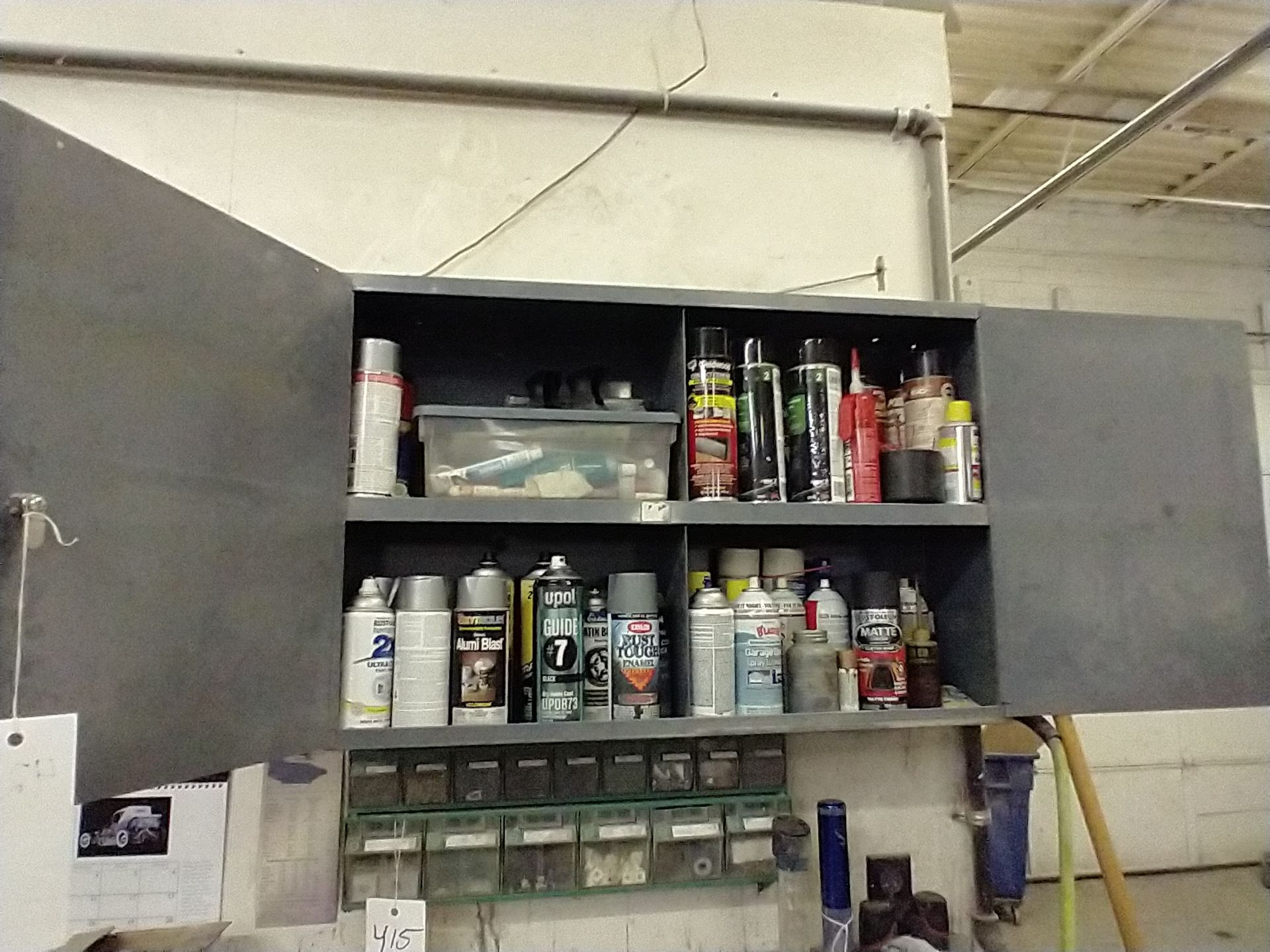 LOT OF SPRAY PAINT AND MISC IN CABINET
