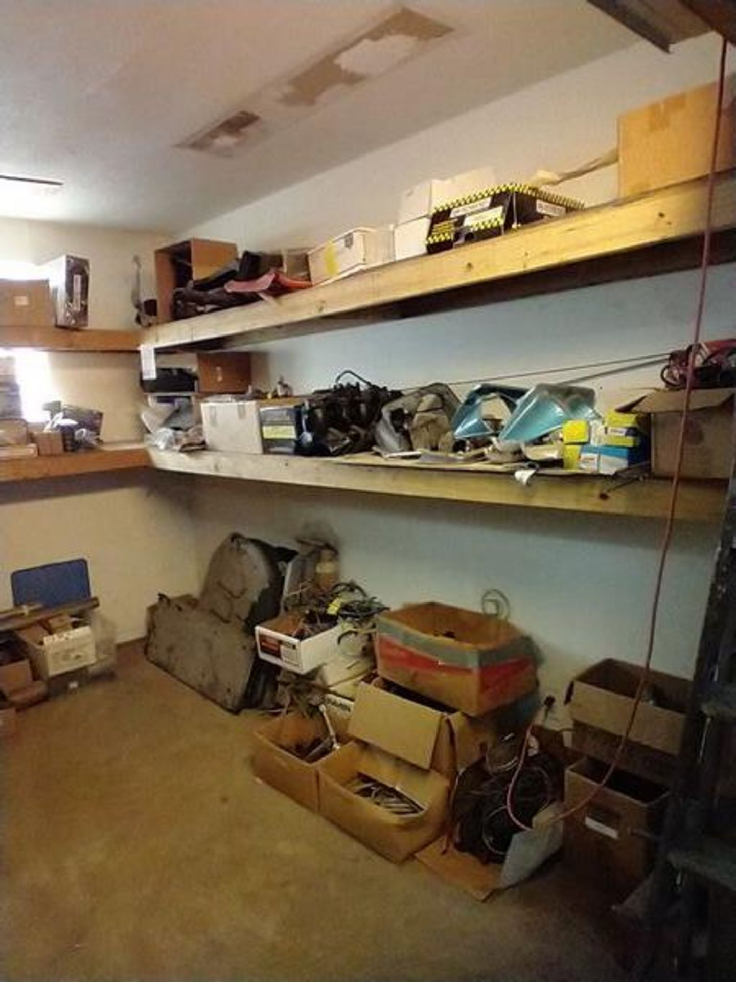 LOT OF ASSORTED CAR PARTS ON 2 SHELVES AND FLOOR