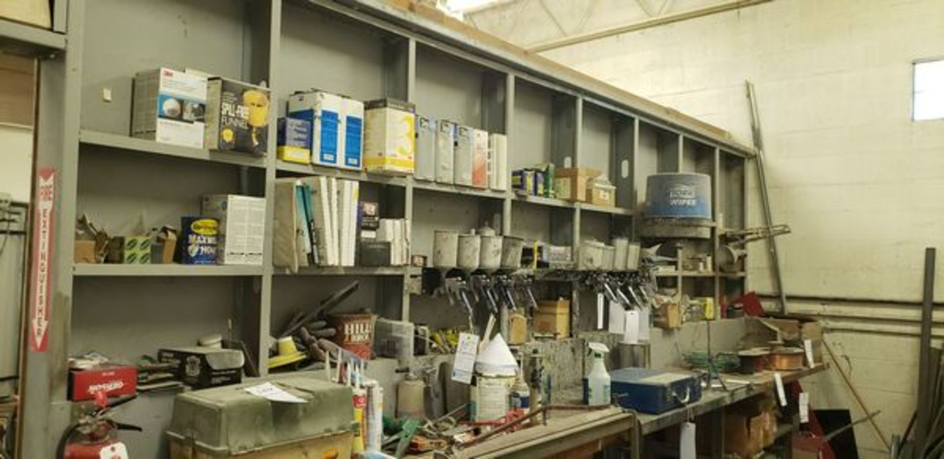 LOT OF PAINTING ITEMS ON LEFT TABLE, TOP AND BACK SHELF (TAGGED SPRAY GUNS AND OTHER TAGGED ITEMS AR
