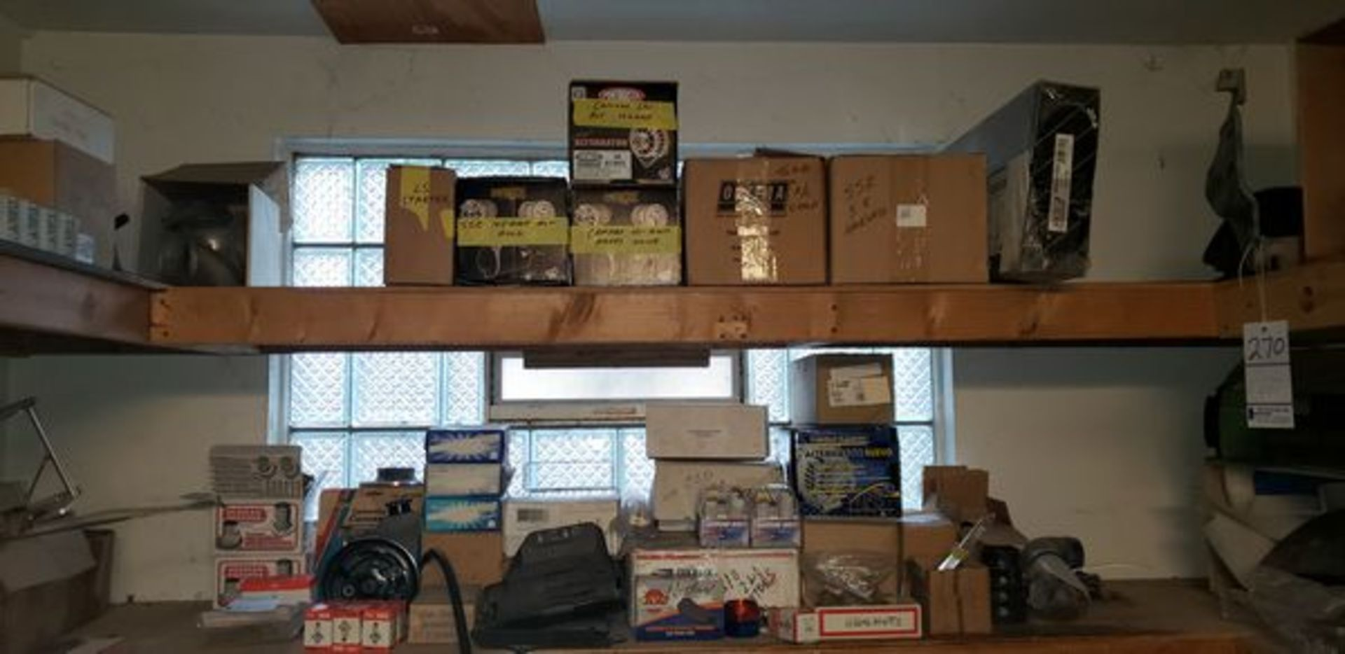 LOT OF ASSORTED CAR PARTS ON 2 SHELVES