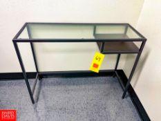"Metal-Framed Glass Desk, 39.5"" Length x 14"" Depth x 29"" Height. Rigging Fee: $75"