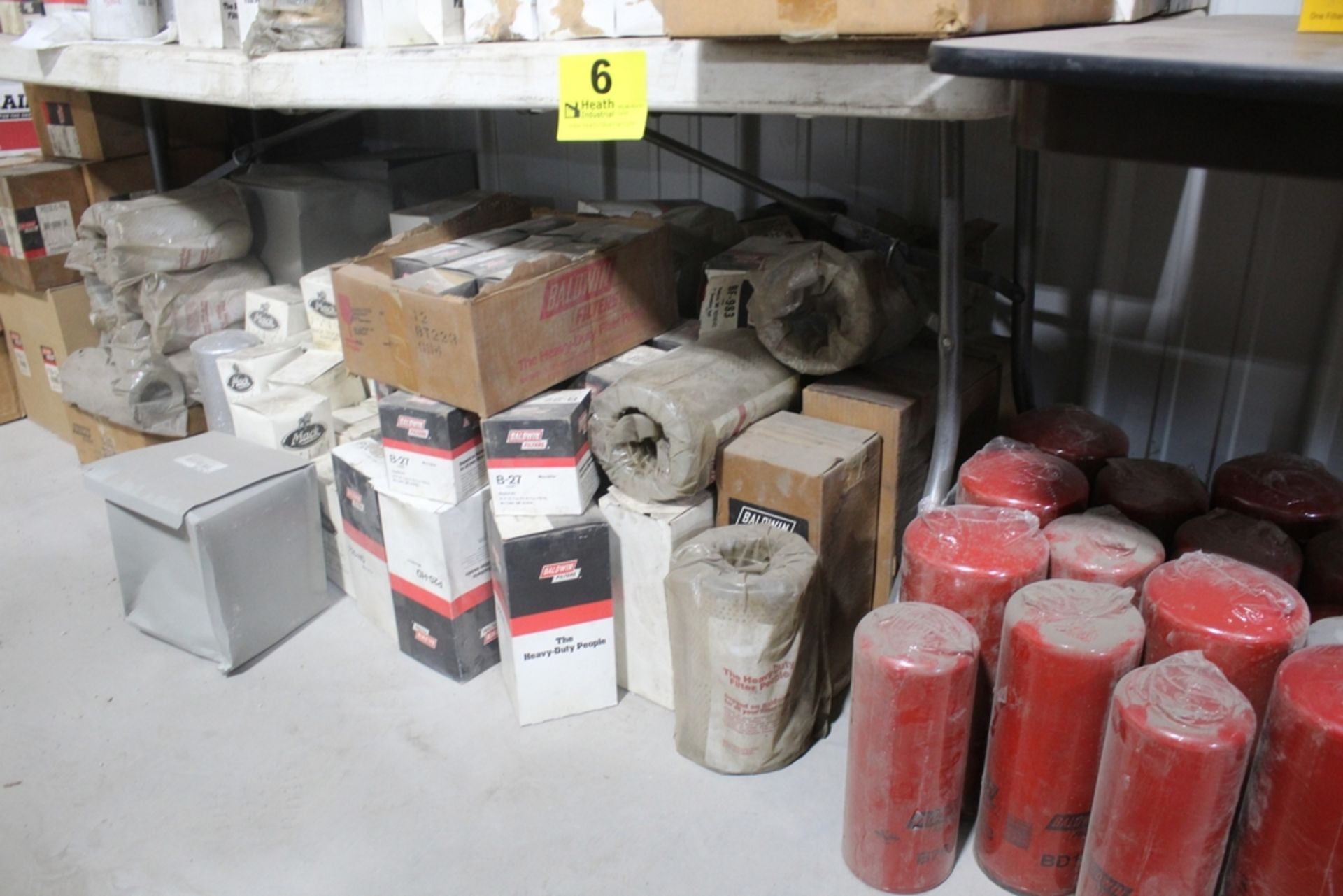 LARGE ASSORTMENT OF MACK AND BALDWIN FILTERS ON TABLE