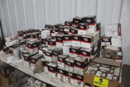 LARGE ASSORTMENT OF BALDWIN FILTERS ON TABLE