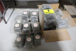 LARGE ASSORTMENT OF CATERPILLAR AND BALDWIN FILTERS ON TABLE