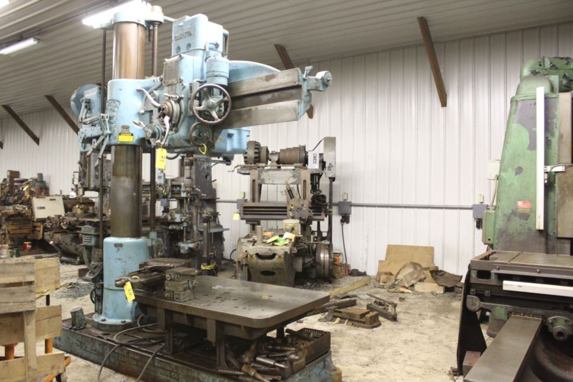 """Carlton radial arm drill, 5' arm, 11"""" column, 9' 9"""" total height, 36"""" x 53"""" bed, misc. tooling."""
