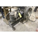 Air compressor, 1/2 HP single cyl., on casters w/hose.