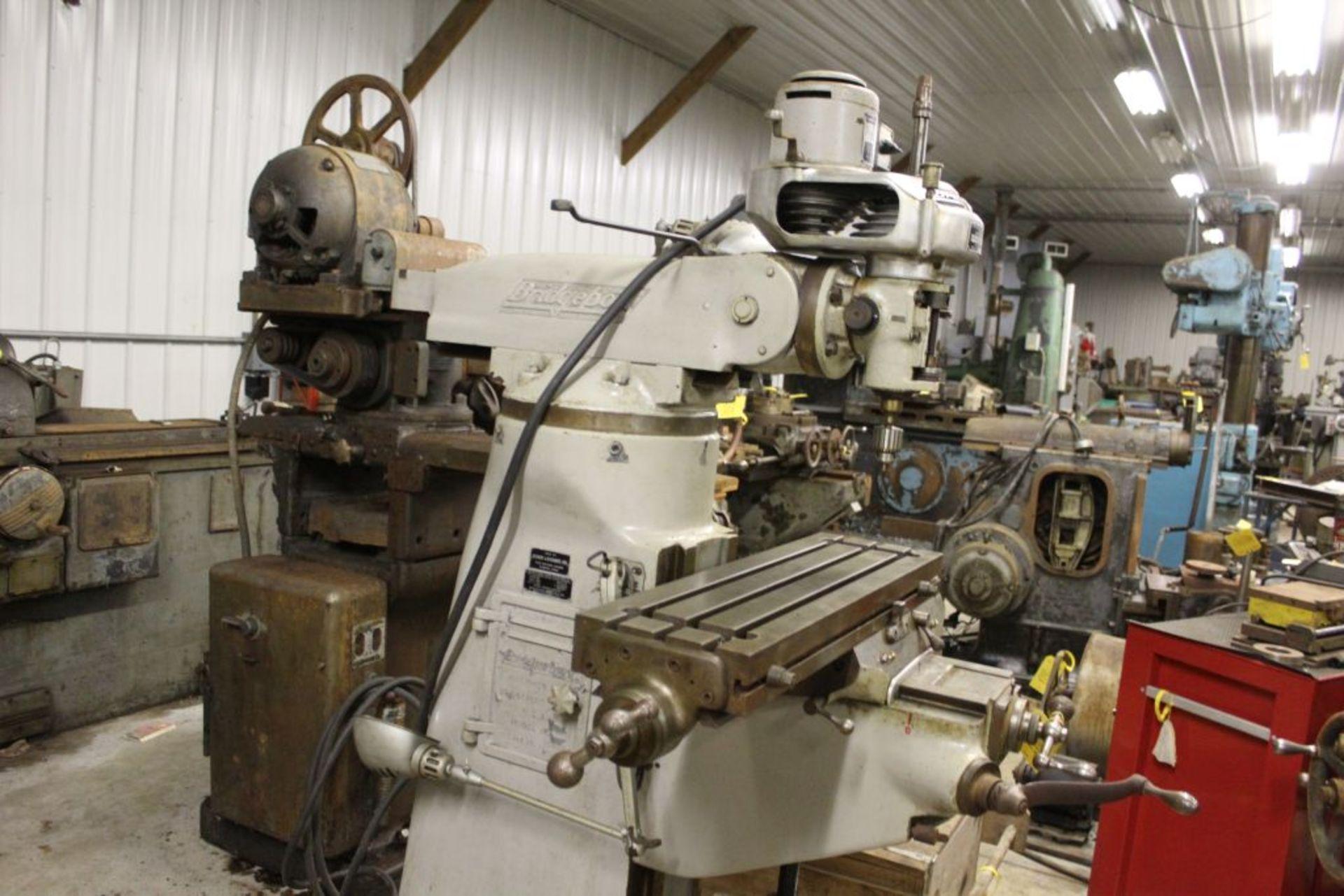 "Bridgeport mill, sn 97974, 6 speed, 9"" x 32"" bed, manual adjustments."