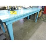 """Wood work table, 73"""" x 31"""" x 31"""", clear poly top."""