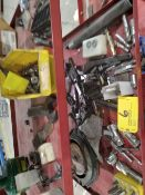 Assorted items on 3 shelves, reamers & bits.