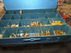 Cabinet of brass fittings: washers, pins, misc.