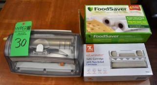Lot c/o: Xyron ezLaminator w/ ezLaminator 60' Two-Sided Laminate Refill Cartridge & FoodSaver Vacuum