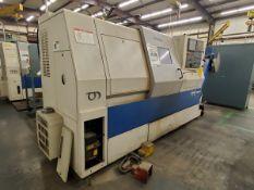 Doosan Puma 240 NC Lathe AC200/220V, 3PH, 50/60HZ, 32.62KVA; X/Z Axis; W/ Hennig Chip Conveyor,