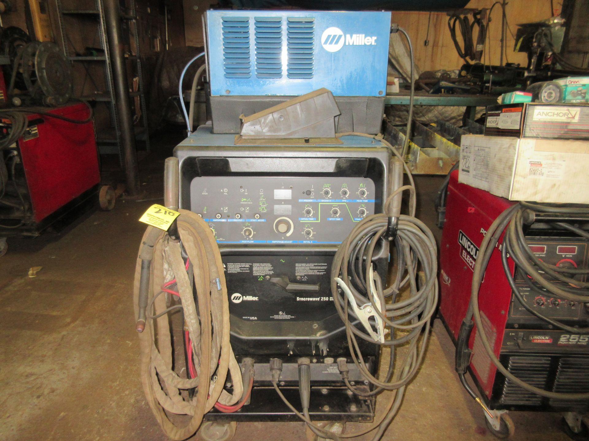 (1) Miller Syncrowave 250DX Welder, S/N LF252203, 115V, w/ Miller Coolmate 3 Cooler, Foot Control