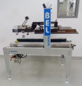 Wexxar BEL Fully Automatic Case Sealer, Model BEL 252, S/N 150973.