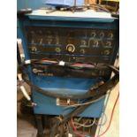 Miller Syncrowave 250 DX welder with work station