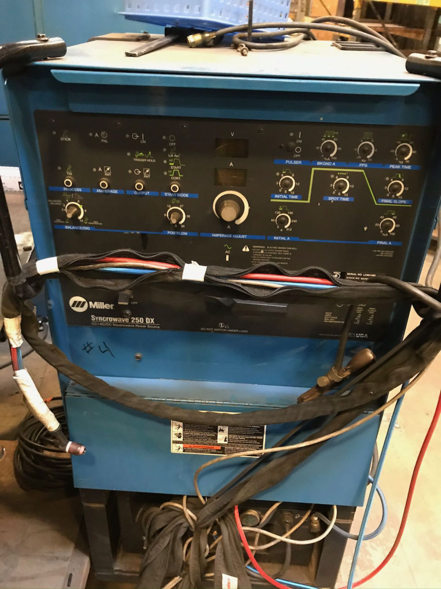 Miller Syncrowave 250 DX welder with work station