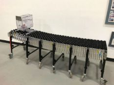 """Best Flex Skate Conveyor. Unit measures 24' long when extended, 78"""" compressed. Height can be"""