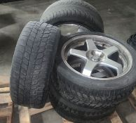 Set of four BLIZZAK tires on rim. Were used on a BMW 750Li (LOCATED IN IOWA, RIGGING INCLUDED WITH