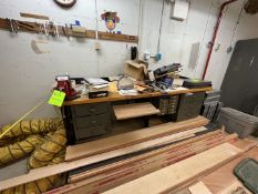 WORKSHOP COUNTERTOP, WOODEN TABLE MOUNTED ON METAL FRAME, VICE MOUNTED, INCLUDES A VARIETY OF