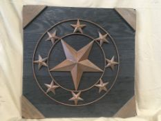 WOODEN WALL ART 24 inch x 24 inch wooden wall hanging with star. Donated by: Rimbey Pharmasave