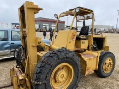 CARE EQUIPMENT 5000LB FORKLIFT S/N 379-T50-51, 13X24R & 9.00-20 RUBBER W/CANOPY, TIRE CHAINS, FORD