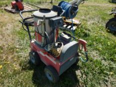 HOTSY HOT WATER ELECTRIC PRESSURE WASHER W/ HOSE REEL, HOSE, AND WASH WAND