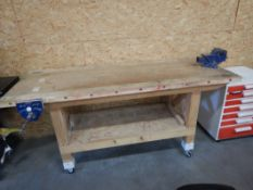 WOODEN SHOP BUILT WORK TABLE W/ 5IN BENCH VISE ON WHEELS - 80INX30INX36IN