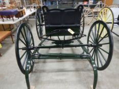 FRESH RESTORATION OF BUGGY W/SHALVES, RUBBER TIRES BY JIM TRONNES