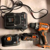 RIDGID 18 VOLT CORDLESS 1/2'' DRILL, MODEL R860052, W/ (2) BATTERIES AND A CHARGER