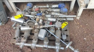 Lot of spare parts, valves, volumetric scales. Please inspect