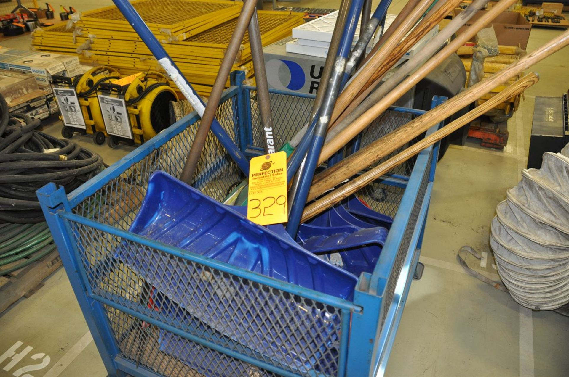Assorted snow shovels and pitch forks, excludes basket/cage