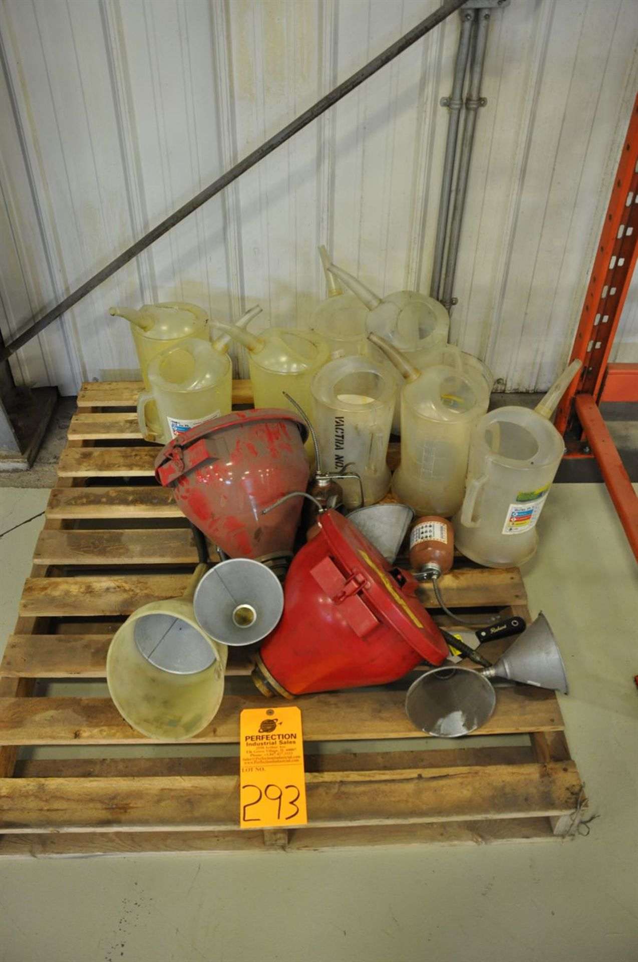 Assorted used oil drum funnels and decanters