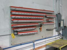 LOT: Assorted Squeegee's on Peg Board on Wall