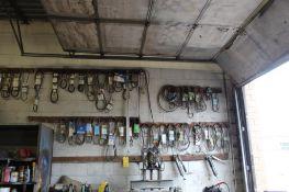 LOT: Rubber Belts and Belt Measurer on Wall