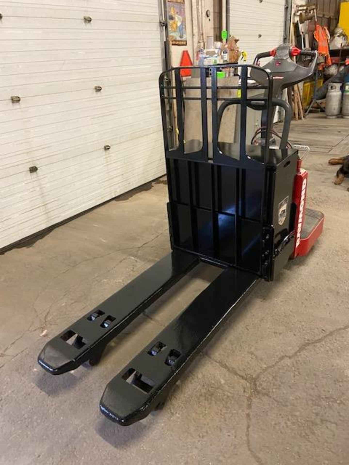 2012 Raymond Electric Ride on Powered Pallet Cart Lift with POWER STEERING 6000lbs capacity 4' - Image 3 of 3