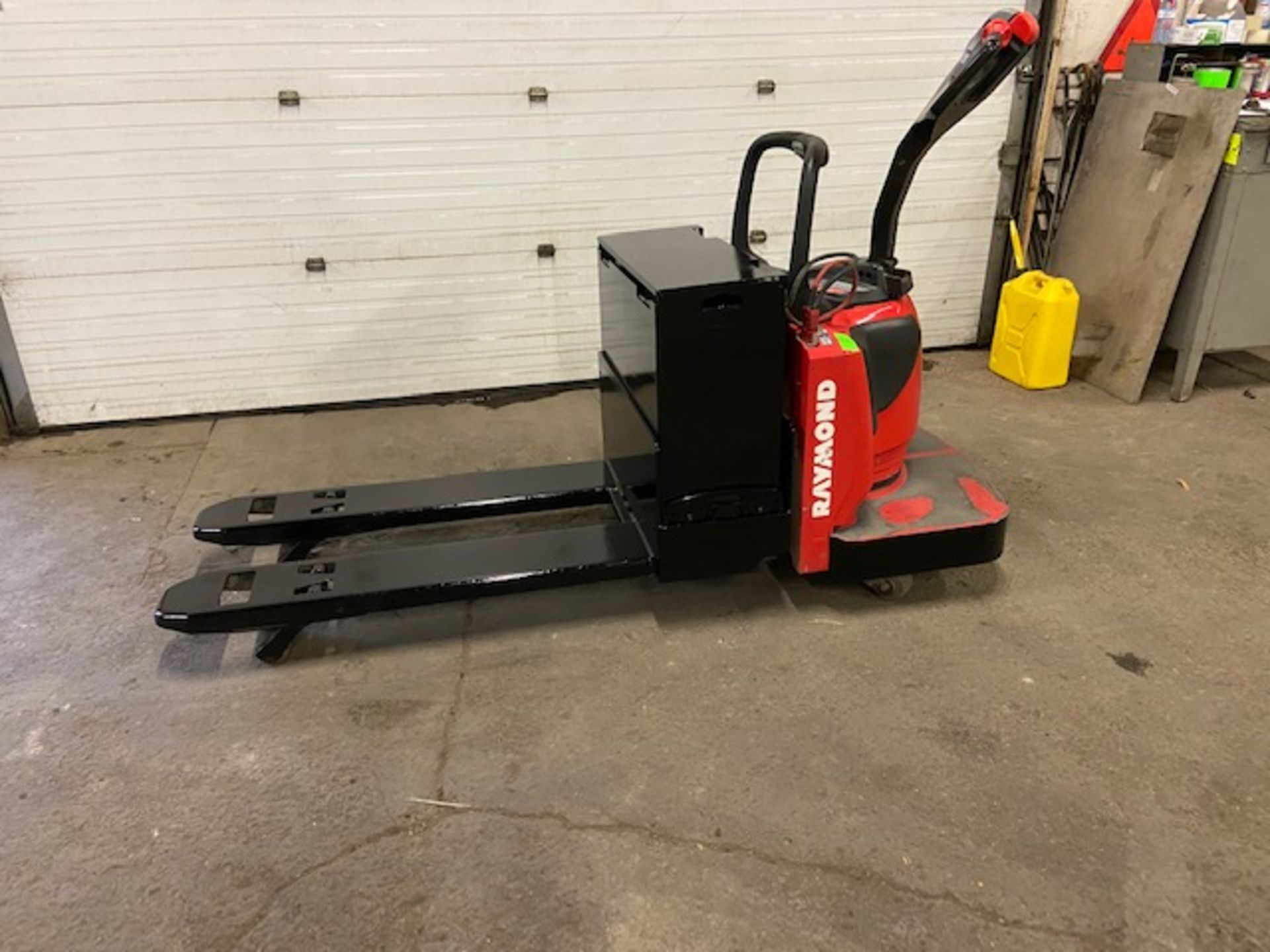 2012 Raymond Electric Ride on Powered Pallet Cart Lift 6000lbs capacity 4' Long with LOW HOURS