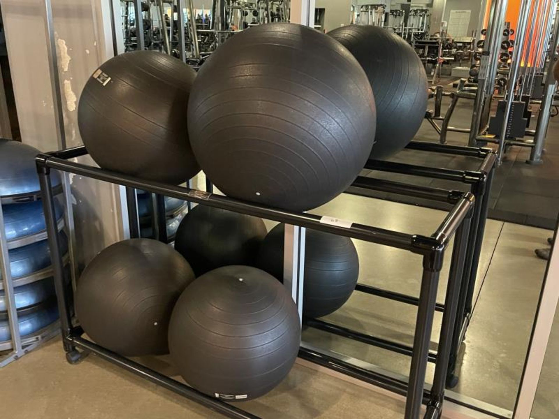 Lot of 4 Versa Ball Pro Balls with Plastic Fitness Wholescale Rack