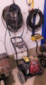 Power Boss 3,000 PSI Gas-Powered Pressure Washer, Honda GC190 Engine with Hose Hanging on Wasll