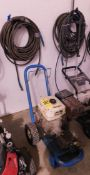 Gas-Powered Pressure Washer, Honda 11 HP Engine with Hose Hanging on Wall