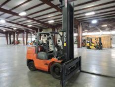"Toyota Model 7FGCU70 Forklift 14,600 lb. Lifting Cap. @ 24"", Hard Tire, LP Gas, 12' Mast, Side"