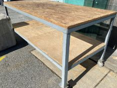 STEEL FRAMED TABLE ON CASTORS