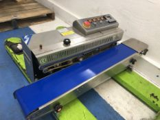Band Sealer model FRBM-8101 Continuous band sealer with coveyor belt and controls. 110 volts.